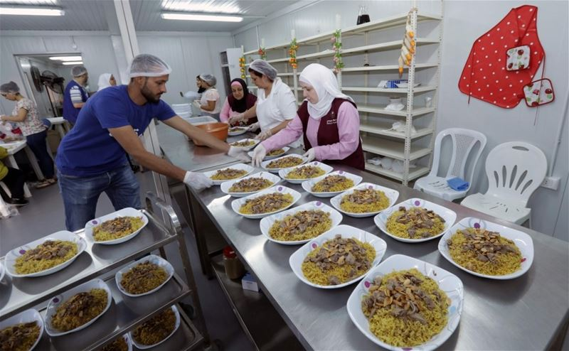 "Lebanese and Syrians prepare dishes for an ""Iftar"" in Beirut, Lebanon. (Anwar Amro / AFP)"