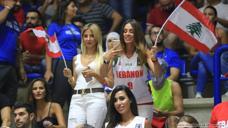 People cheering during the FIBA Asia Champions Cup Between Lebanon and South Korea, in Zouk Mikael north of Beirut, Lebanon. (Hussein Baydoun / Alaraby AlJadeed)