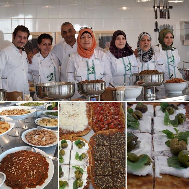 The cooks gather around their savory creations at Tawlet Saida... The...