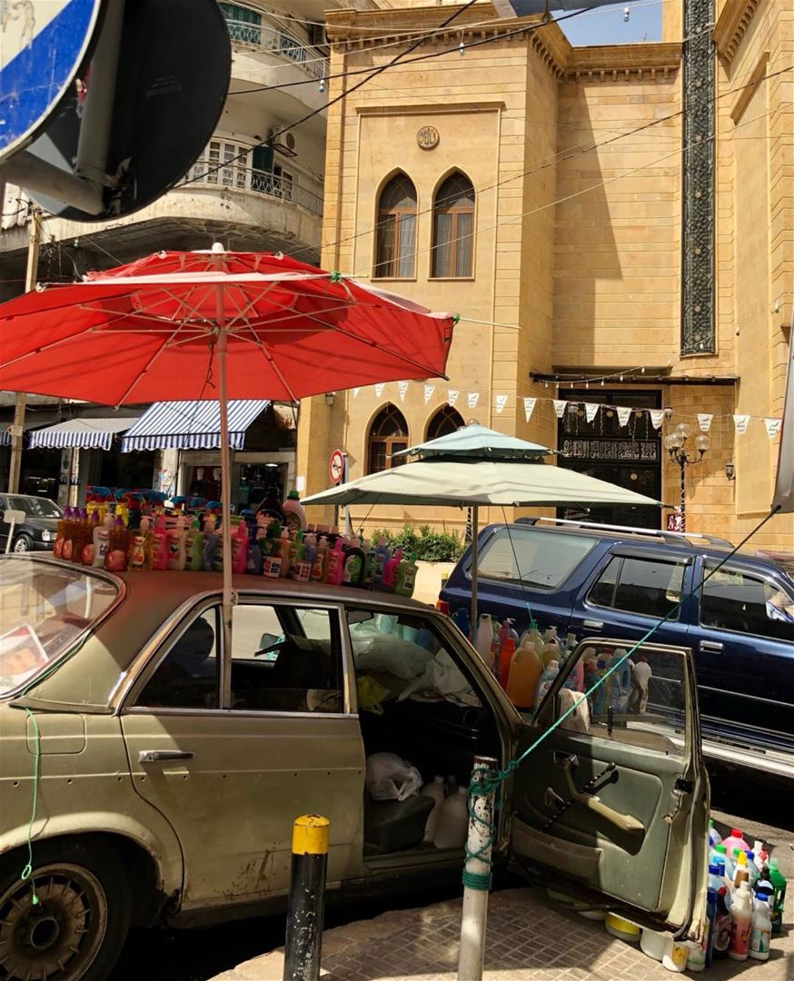 Car store in front of the mosque in a busy Beirut 'hood, specialising in...