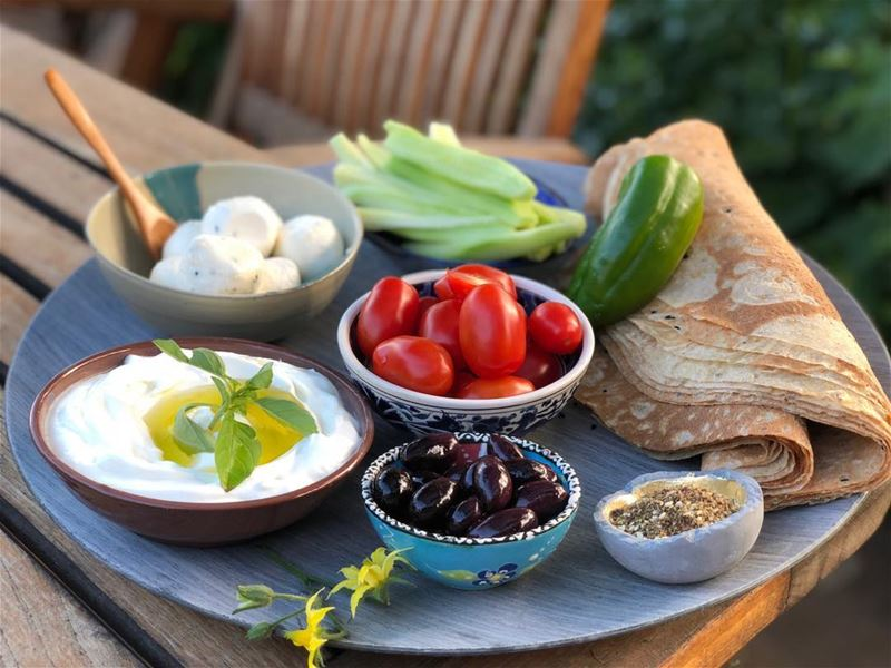 Breakfast alfresco, with the usual.  lebanesebreakfast  labneh  rawveggies...