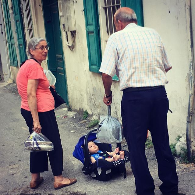 """He's not mine"" the man says ...  baby  streetphotography  lost  elder ... (Mar Mikhael-Armenia The Street)"