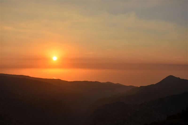 A sunset's orange hues over the mountains of North Lebanon and their... (Bcharreh, Liban-Nord, Lebanon)