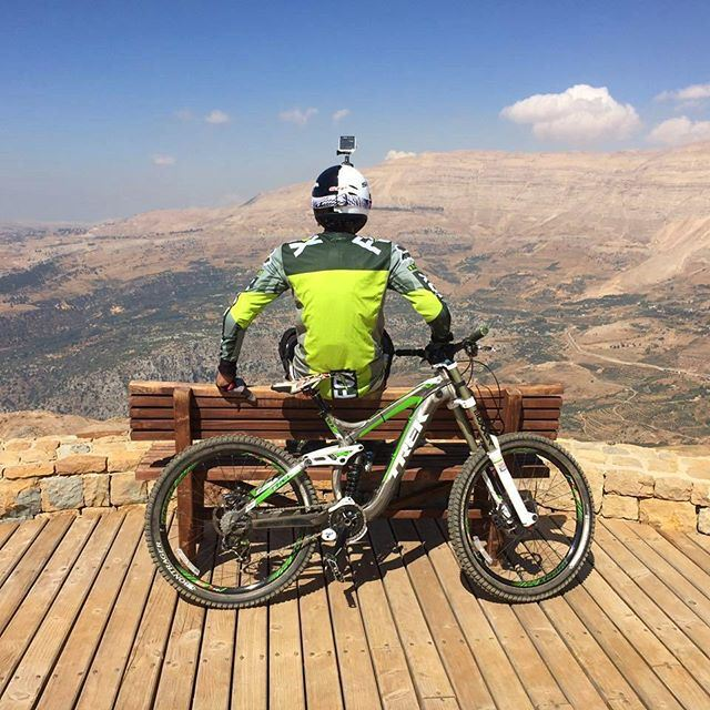 When you have adventures ahead of you, lay your back on your monster  bike and enjoy the view.  downhill