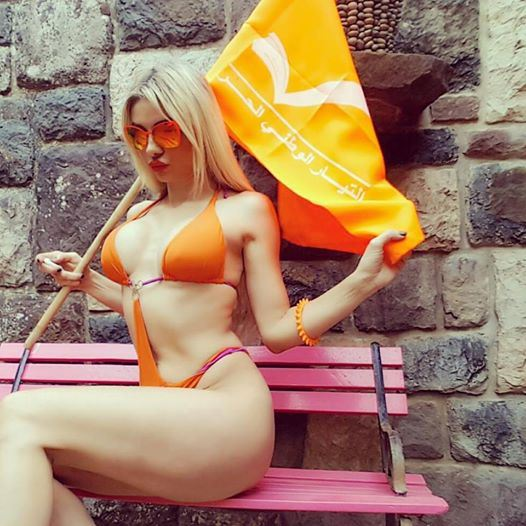 Myriam Klink in Orange Swimsuit Supporting Aoun