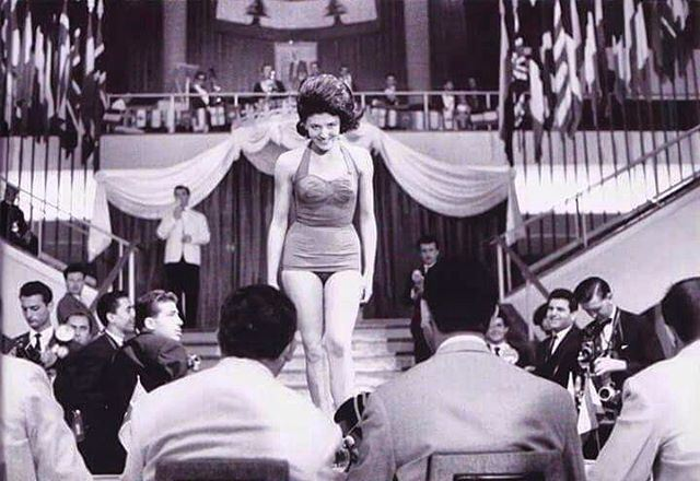 "Miss Universe 1962 , A candidate Standing in front of the jury ""Casino Du Liban"""