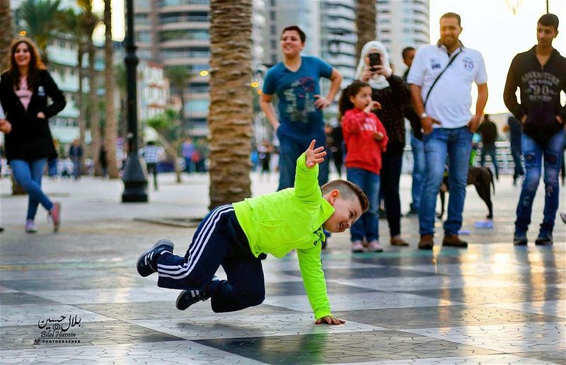 Mahmoud performs a breakdance on the Mediterranean waterfront promenade in...