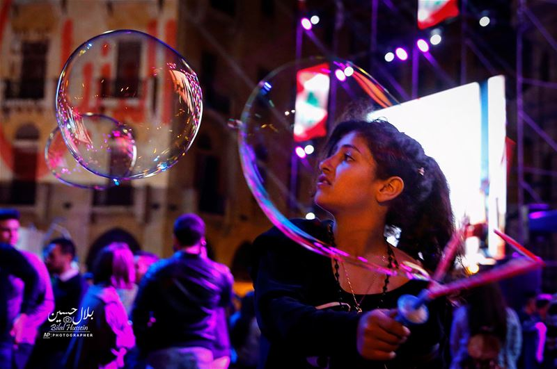 Children blow soap bubbles, during celebrations of Mother's Day in central...
