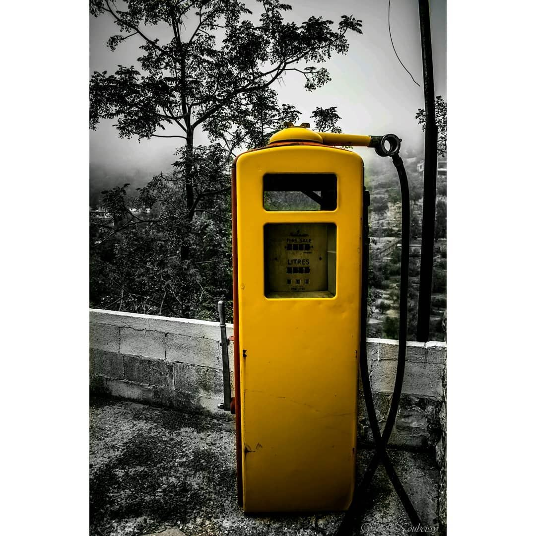 bnw abandoned old gas pump yellow blackandwhite lebanon trees