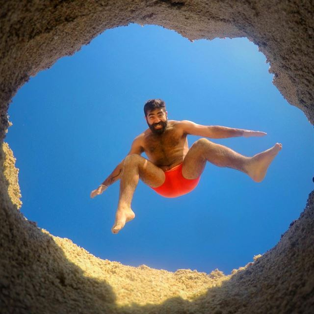 A Hole New World 🕳 jump  fun  hole  legs  sky  summer  beach  beard  air... (Bahr Sour)