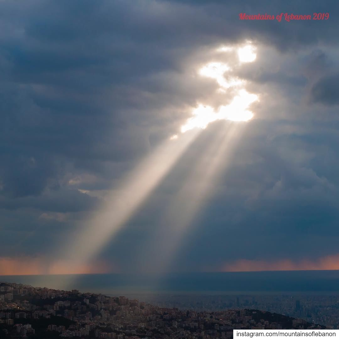 Two rays of sun piercing the clouds... can go for divine inspiration, or...