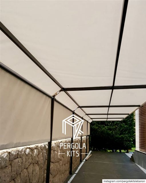 Plain Fabric Roofing on a Slim Metal Structure Pergola Kits. ...