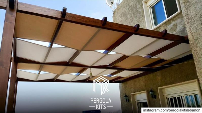 Attached Pergola with Mix of Fabric Roofing!  PergolaKitsLebanon...