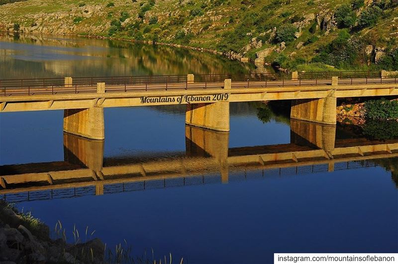 Just a bridge and its reflection during golden hour...... roadtrip ... (Lac de Qaraaoun)