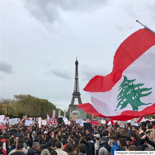 """All of them means all of them!"" We stand with you Lebanon! 🇱🇧....... (Eiffel Tour, Paris, France)"