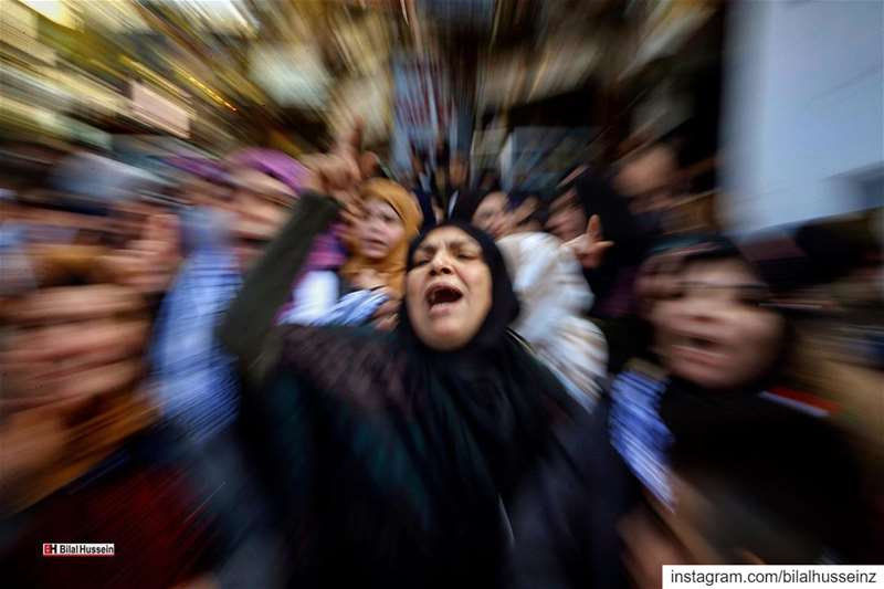 In this photo made with a slow shutter speed, Palestinian chant slogans...