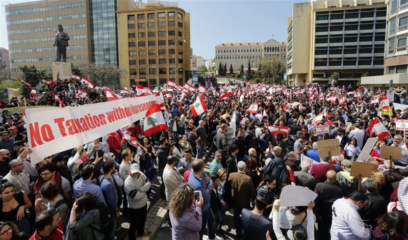 Lebanese protest against new high taxes in front of the government palace in Beirut. (NABIL MOUNZER / EPA)  via pow.photos
