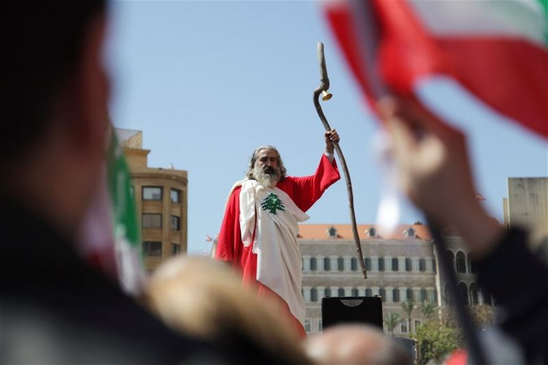 A man dressed up in a Lebanese flag attends a demonstration against proposed tax increase, in Beirut. (Alia Haju / REUTERS) via pow.photos