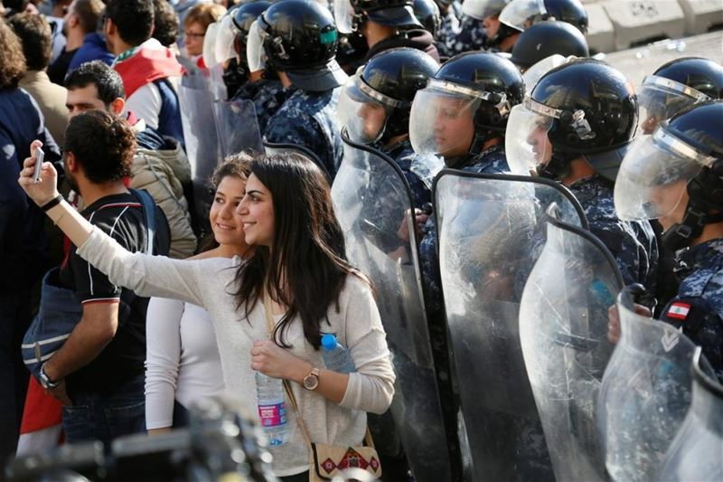 Taking a selfie with security forces during a protest in Beirut. (Ratib Al Safadi / Anadolu Agency) via pow.photos