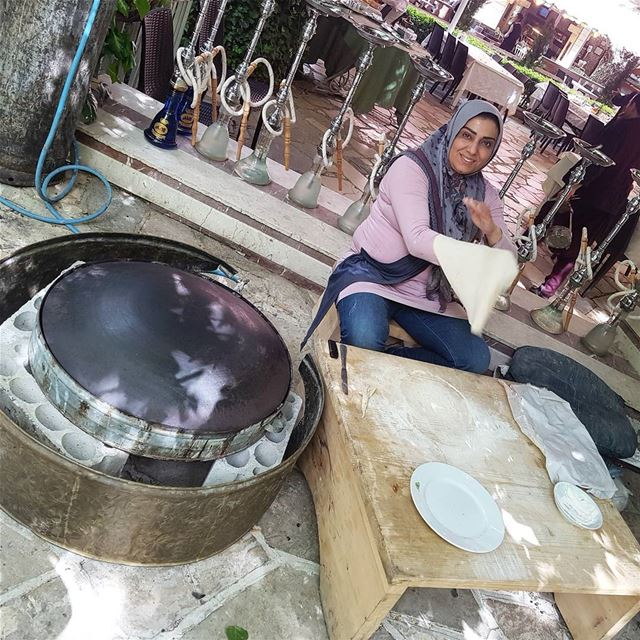 A local woman gives a demonstration how to make a Lebanese flatbread. She... (Zahlé, Lebanon)