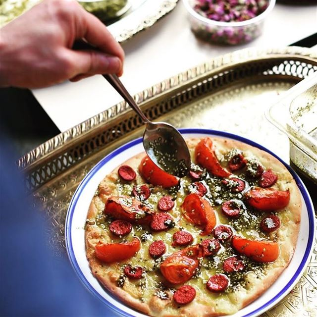 The love of cooking.. freshly baked Halloumi cheese, roasted tomatoes,... (Comptoir Libanais)