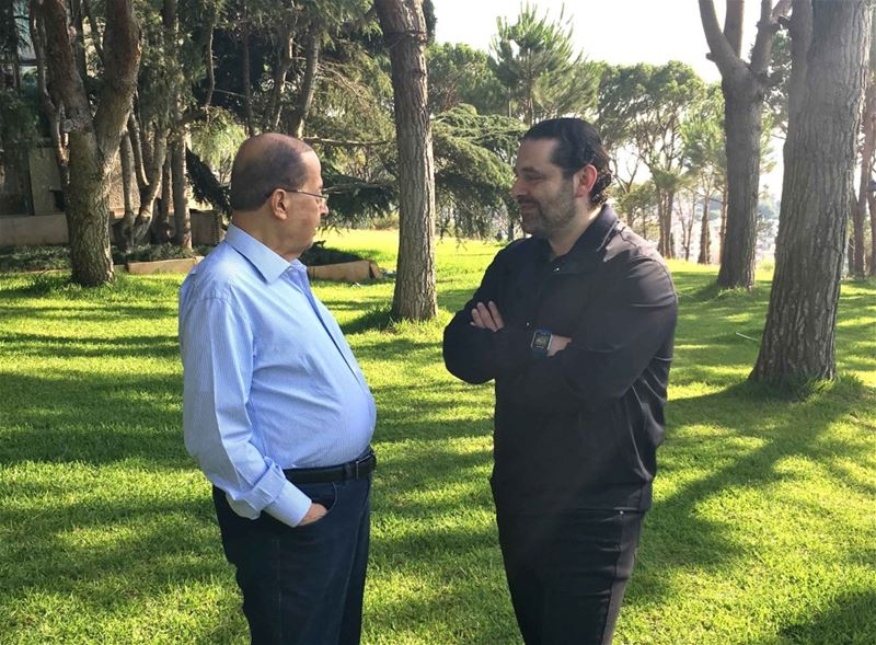 President Michel Aoun walking with Prime Minister Saad Hariri in the garden of the presidential palace of Baabda. (Dalati And Nohra)