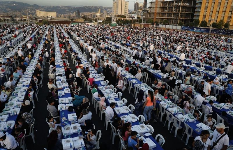 Lebanese citizens, Orphans and Syrian refugees, gather around longest Iftar tables in the world, in Beirut, Lebanon. (Hussein Malla / AP)