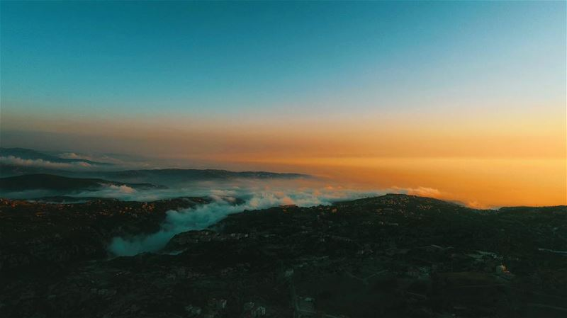 Lebanon's sunset from an above the cloud's view; droning high ... (Souk el Akel)