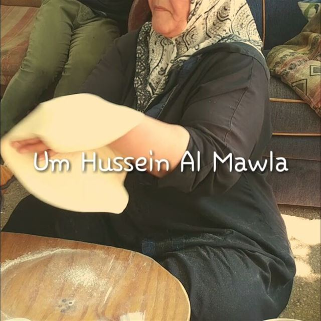 Um Hussein Al Mawla from Laboueh (Bekaa) making manaeesh from scratch on a... (Bekaa)