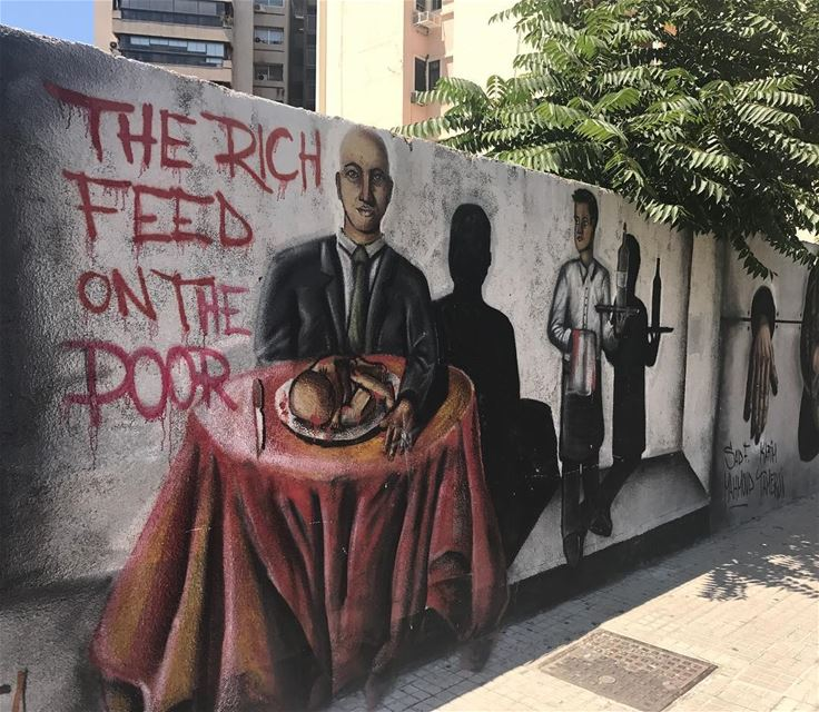 """THE RICH FEED ON THE POOR"" - A graffiti that tackles a dangerous... (Verdun)"