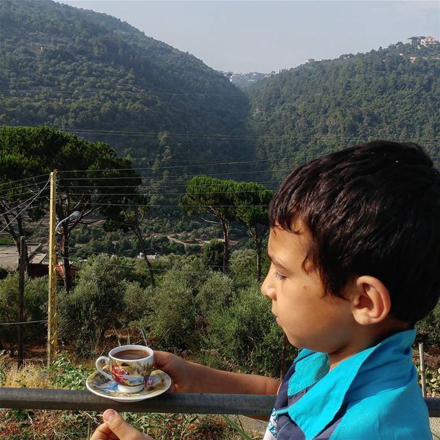 Wassim, 10, is setting my coffee prepared by his older brother against the... (Dayr Al Qamar, Mont-Liban, Lebanon)