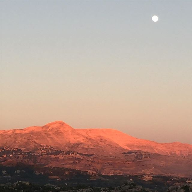 The  moon and the red  sunset over my beloved  mountains  landscape ...