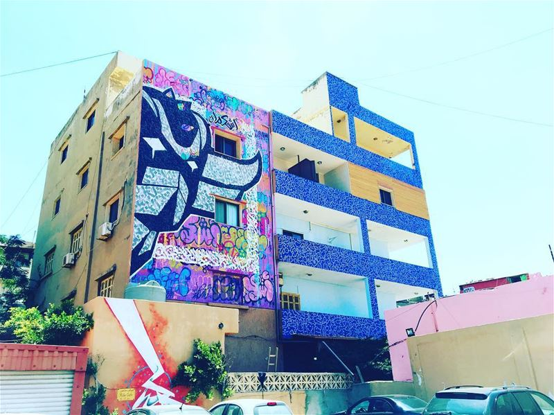 Residential flats transformed into a colourful canvas by @ashekman, @potato (Ouzaie)