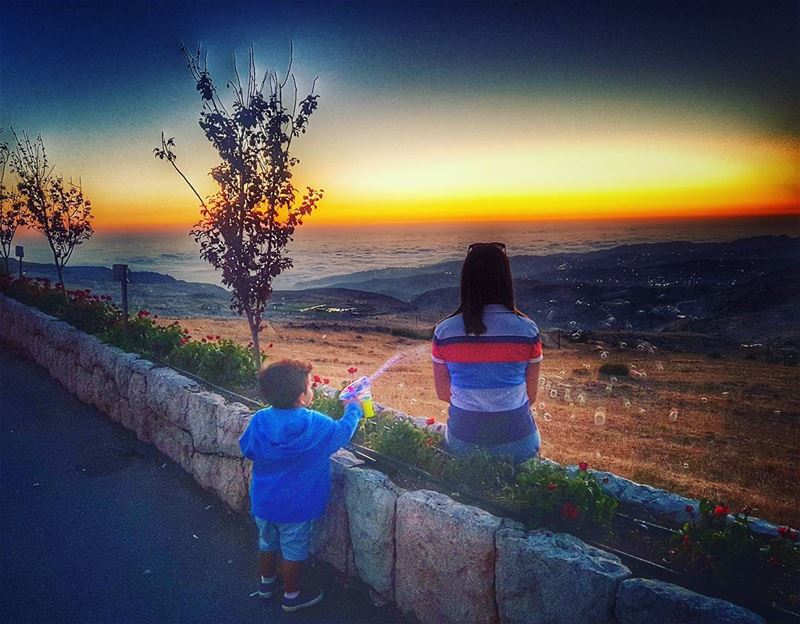 His  watergun meant for him much more than the amazing  sunset ahead 💏... (Qanat Bakish, Mont-Liban, Lebanon)