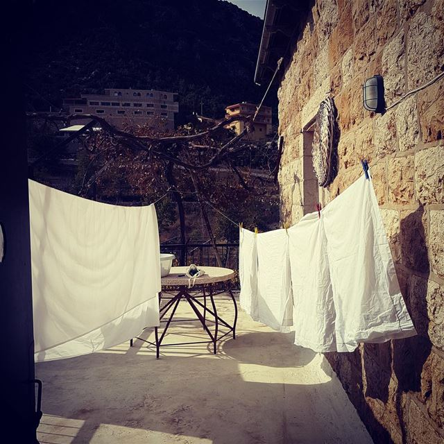 Bed sheets drying in the open, fresh air. Taking their time. Like in the...