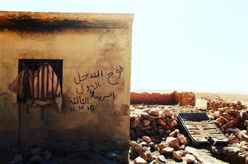 Graffiti on the wall of a filthy hut, home to ISIS fighters for three... (Ḩalīmah)