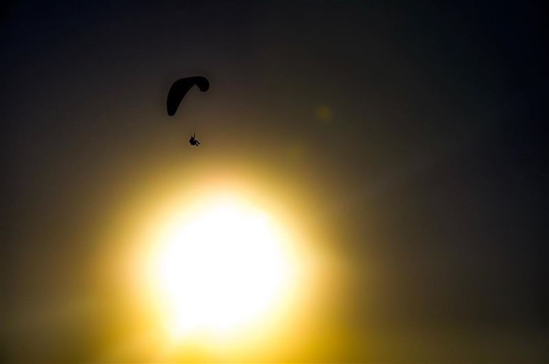Paragliding above the sun.   sunset  sun  dawn  paragliding  fly  sports ... (Harîssa, Mont-Liban, Lebanon)