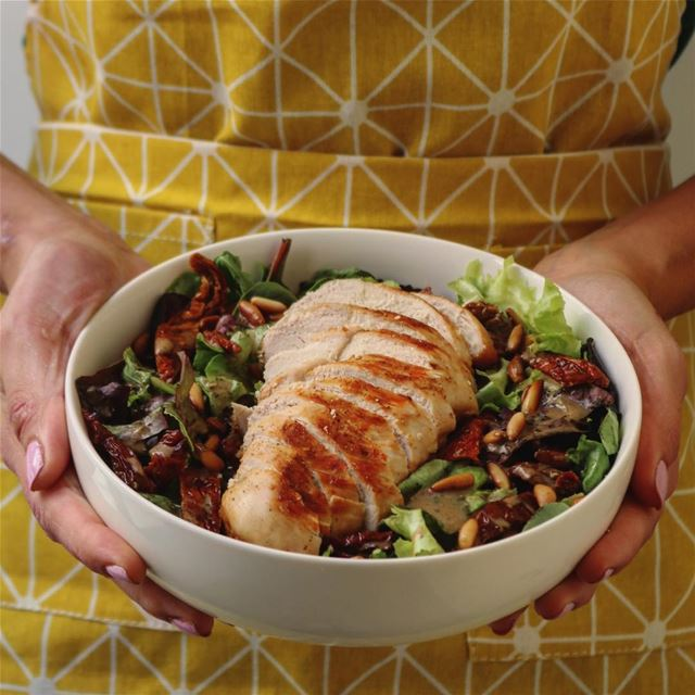 Mixed greens, roasted pine nuts, sun-dried tomato, and grilled chicken...