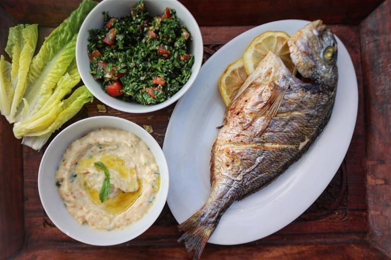 Oven grilled fish, mom's tabbouleh and mtabal batenjen; the perfect... (Ansar, Lebanon)