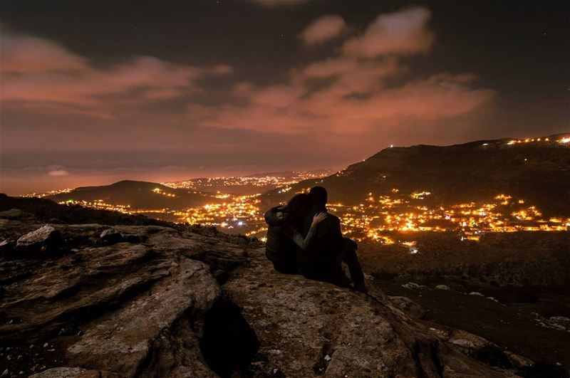 Love is...A shoulder to lean on...... love night rock clouds lights... (Jabal Şannīn)