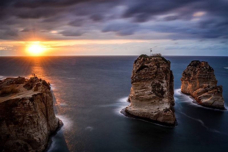 A stormy sunset | The Pigeon rocks of Rawche, Beirut  livelovebeirut. 45... (Beirut, Lebanon)