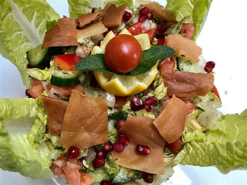Fattouch Salad:Leafy lettuce, fresh chopped tomatoes, cucumbers and...