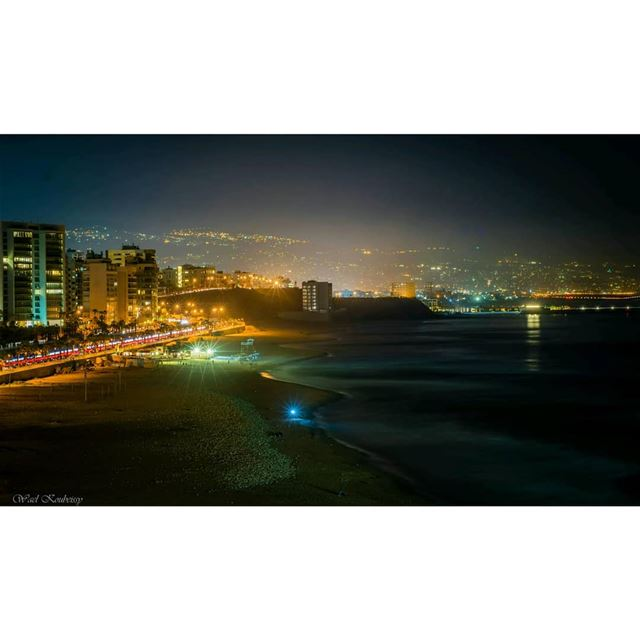 beirut  lebanon  beach  night  coast  sea  buildings  rocks  road  cars ... (Ramlat Al Bayda', Beyrouth, Lebanon)