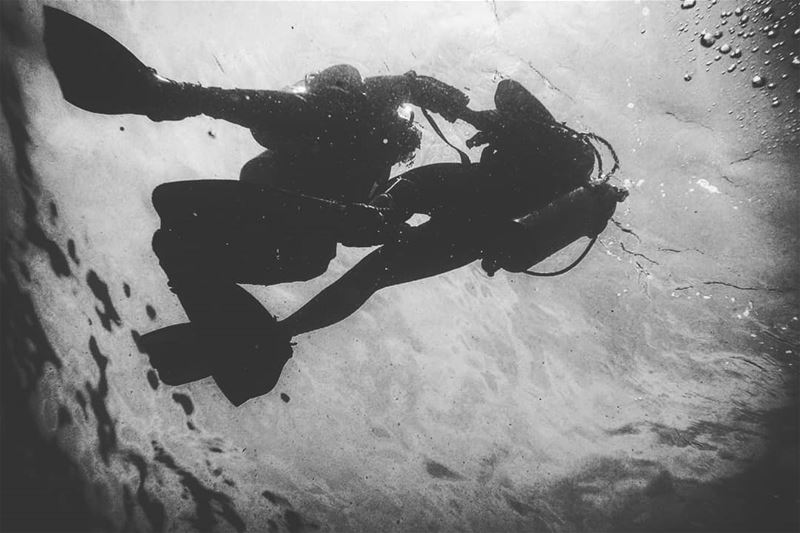 Diving couple -  ichalhoub in  Batroun north  Lebanon shooting  underwater...