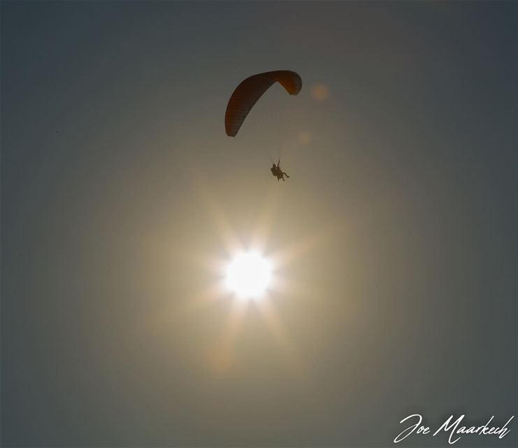 Life is either a daring adventure or nothing!  paragliding  sky  sun ...