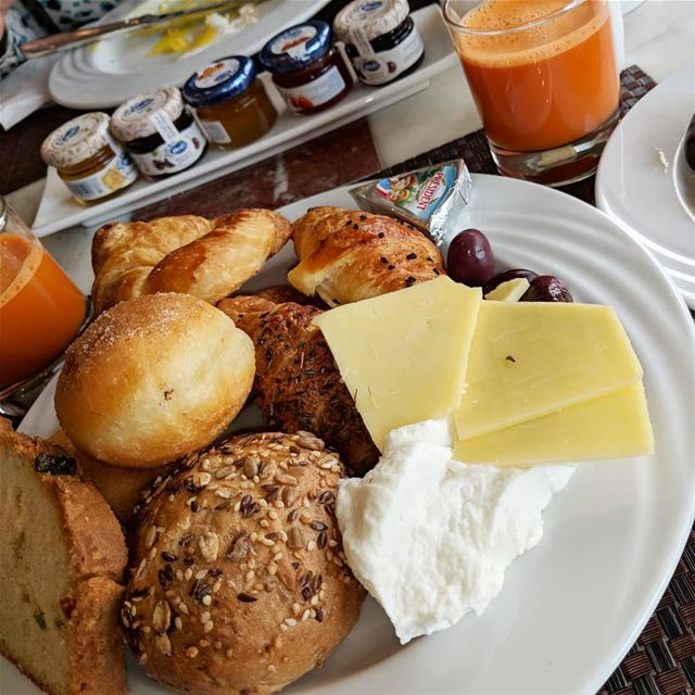 yummyfood😋   bread  cheese  labneh  olives  juice  carrotjuice ...