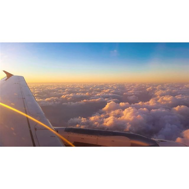 sunset from from above the clouds mesmerizing breathtaking view airplane...