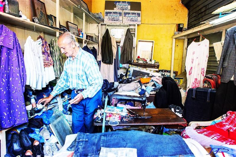 Old tailor at his shop