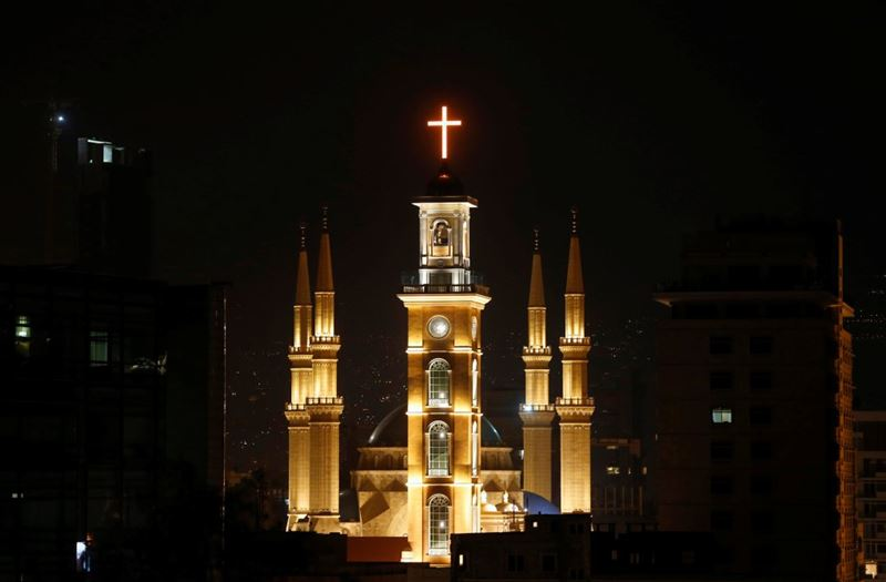 Saint George Maronite Cathedral's cross is lit during the inauguration of its bell tower in downtown Beirut.