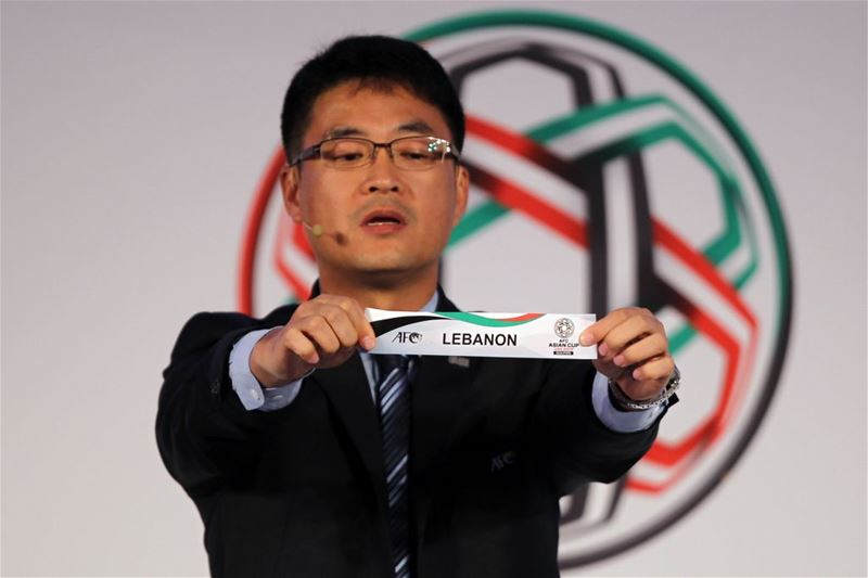 Shin Man Gil, Executive Director AFC Competitions Division, draws Lebanon during the AFC Asian Cup UAE 2019 Qualifiers Final Round draw in Abu Dhabi. (NEZAR BALOUT / AFP)